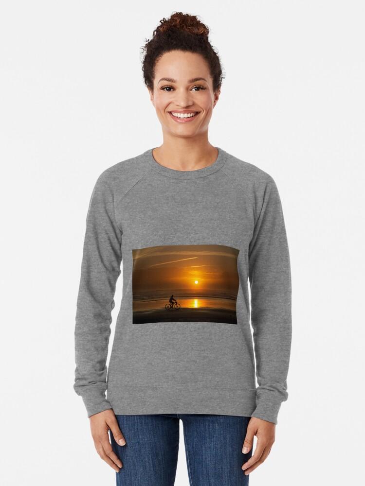 Alternate view of Silhouette of a cyclist along Cannon Beach Oregon Lightweight Sweatshirt