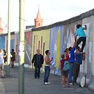 Adding a little piece to history, Eastside Gallery, Berlin, Germany June 2010.  by Anna  Goodhind