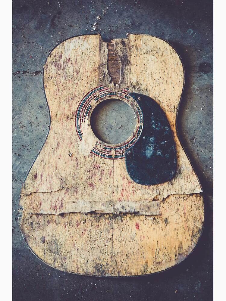 Broken acoustic guitar by Juhku