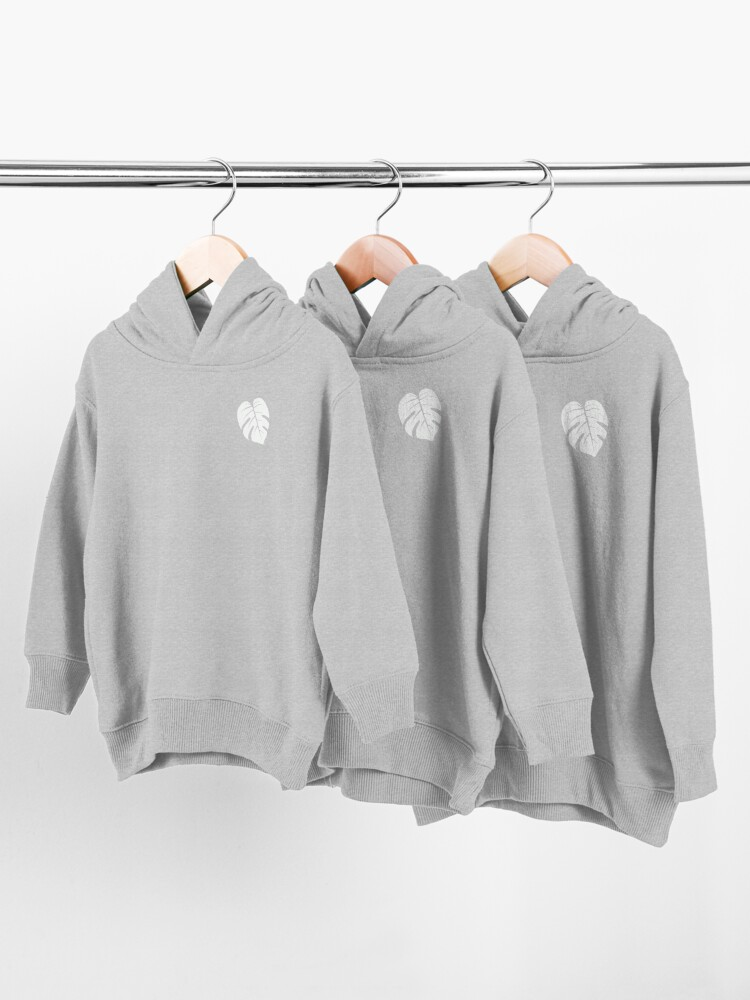 Alternate view of Tropical Heart. Monstera Deliciosa Leaf in White on Blush 1 Solid. Minimalist Botanical Design Toddler Pullover Hoodie
