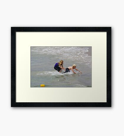 Playing in Surf Framed Print