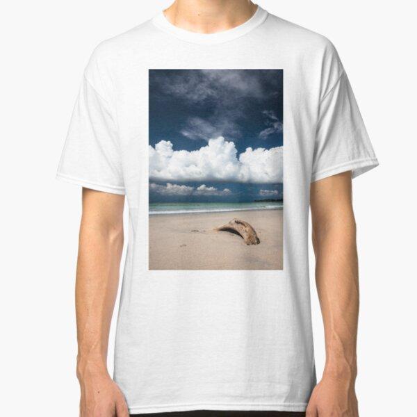Beach driftwood and dark blue sky Classic T-Shirt