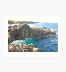 Ocean underneath rock outcropping Art Print