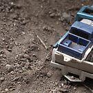 Little toy trucks by Oceanna Solloway
