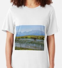 Bison Herd by a Lake Beneath Hazy Mountains Slim Fit T-Shirt