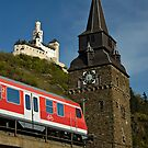 Train passing Marksburg Castle, Braubach, Rhine Valley, Germany. by David A. L. Davies