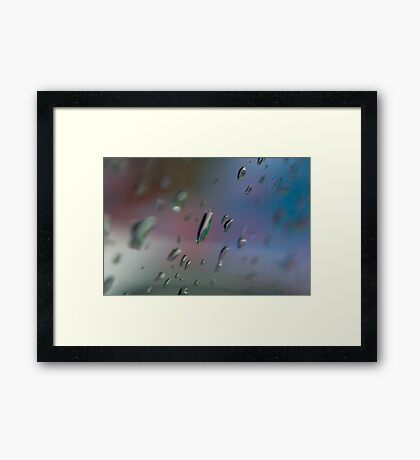 raindrops on glass Framed Print