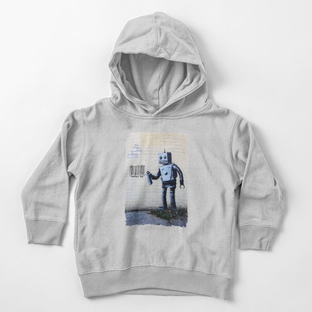 Banksy graffiti smiling Robot and barcodes Better Out Than In New York City residency on brick wall Toddler Pullover Hoodie