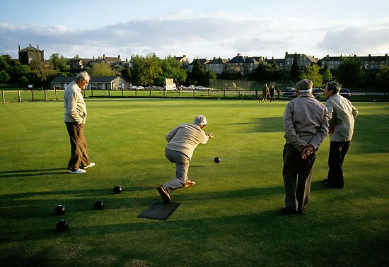 Men enjoying a game of bowls, England, 1980s. by David A. L. Davies
