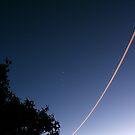 Night Jet Light Trail by Raoul Isidro