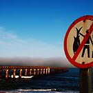 Warning sign stormfront, Namibia by MacLeod