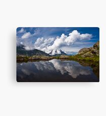 Trolls' clouds reflecting in Norwegian mountain lake. Canvas Print