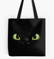 Toothless fiery eyes Tote Bag