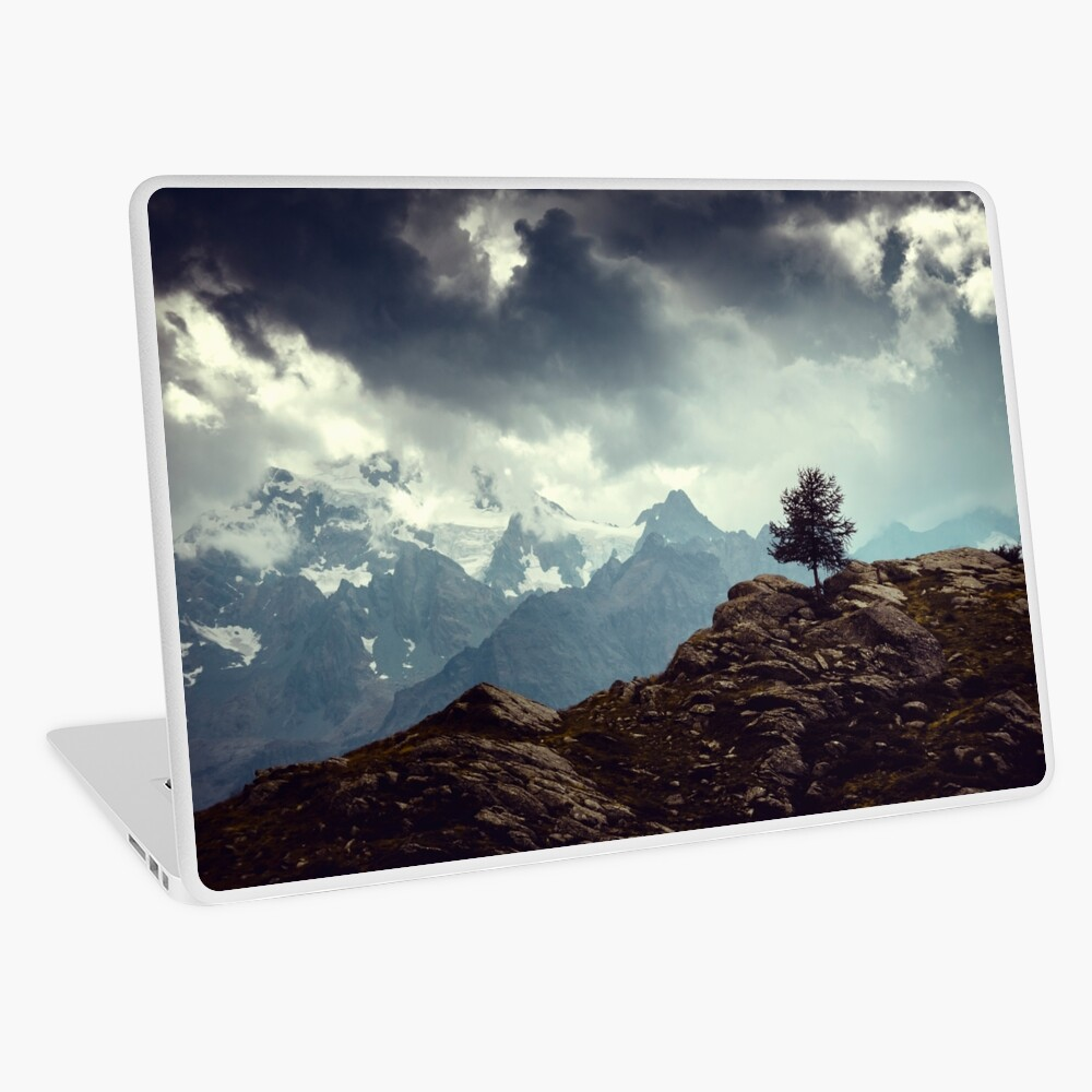 Majestic Mountains and a lone tree Laptop Skin