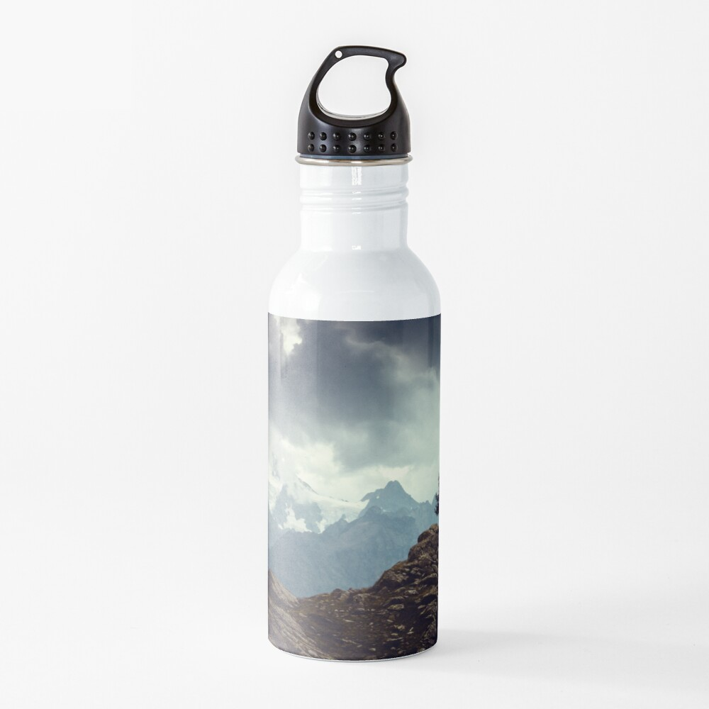 Majestic Mountains and a lone tree Water Bottle
