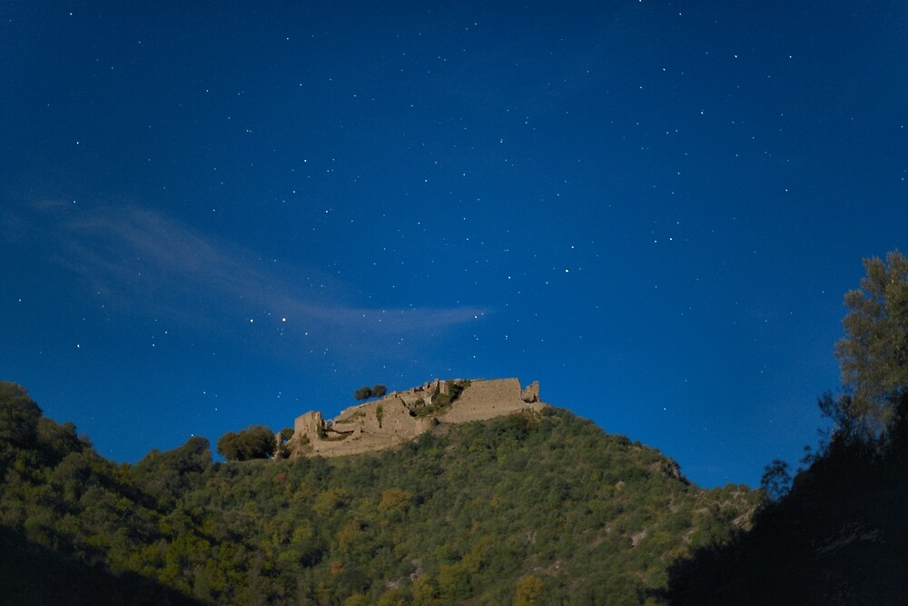 The castle of Termes under the full moon by Philippe Contal