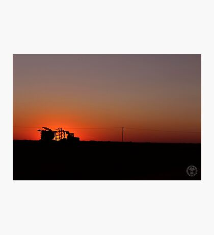 Seeder at Sunset Photographic Print