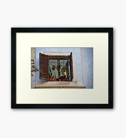 Finestra sulla piazza! Framed Print
