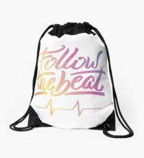 Follow the beat in colors Drawstring Bag