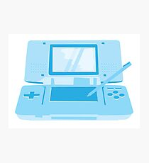 handheld computer game system in blue Photographic Print