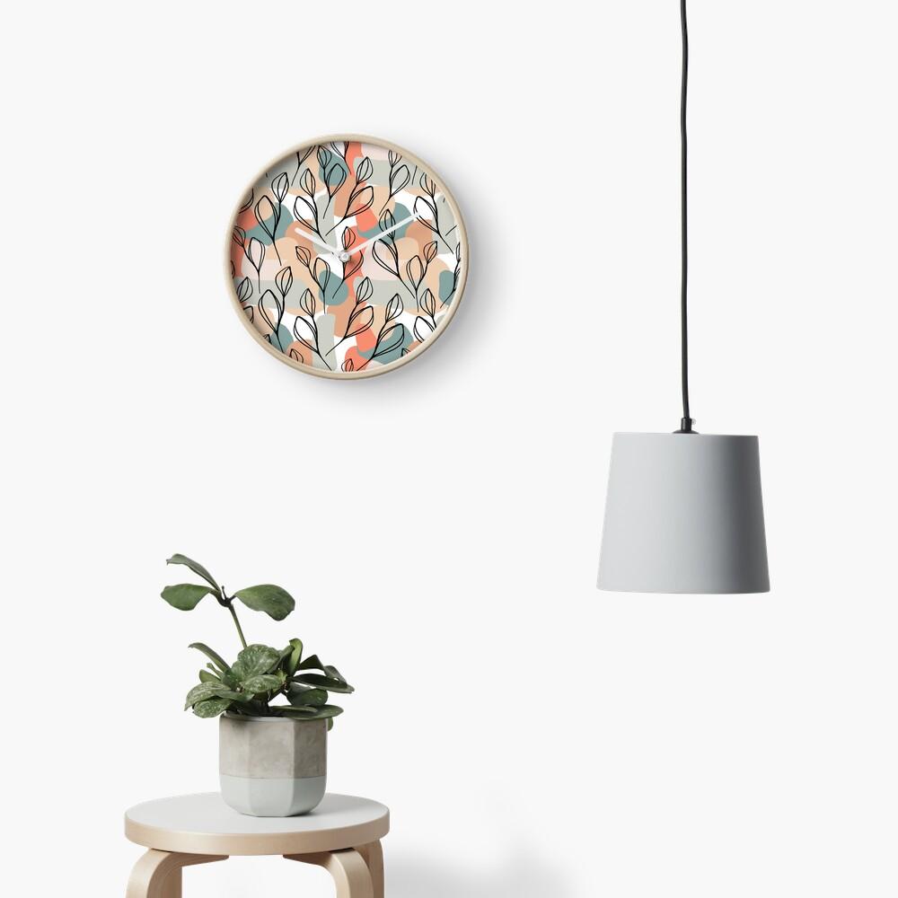 Schwarzblätter und Pastellhintergrund Uhr