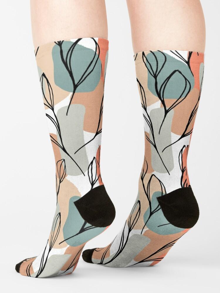 Alternative Ansicht von Schwarzblätter und Pastellhintergrund Socken