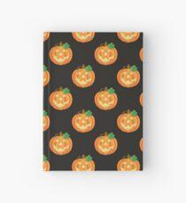 Halloween Pumpkins on Black Background Hardcover Journal