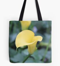 looking at a lily Tote Bag