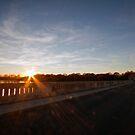 Sunset from the bridge at Silver Lake Park. by Edward Mahala