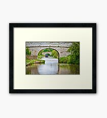 Longboat Through the Arches Framed Print