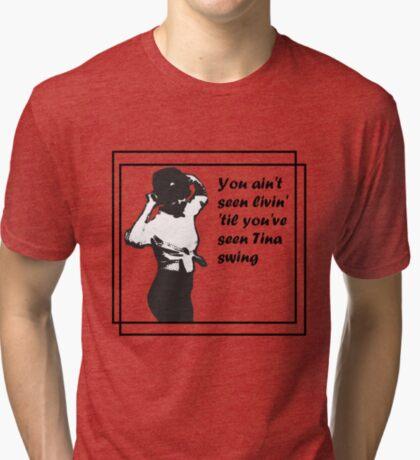 You Ain't Seen Livin' 'Til You've Seen Tina Swing (plain bg with squares) Tri-blend T-Shirt