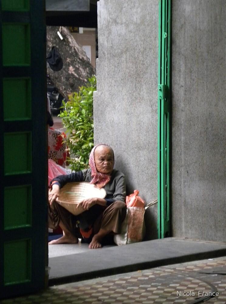 Old Vietnamese lady in doorway by Nicola  France