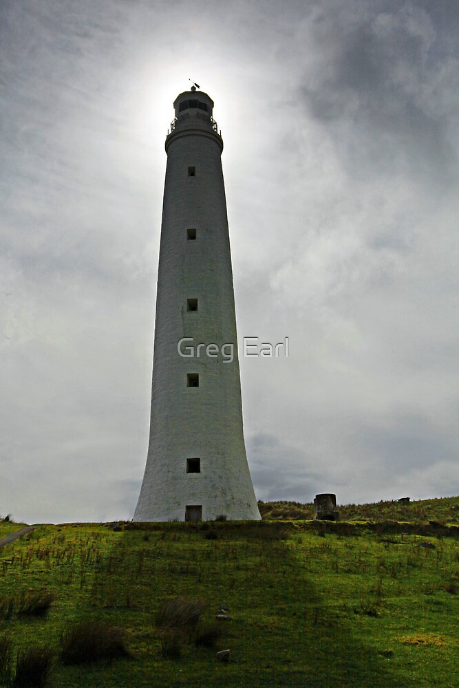 In The Shadow - Cape Wickham, King Island by Greg Earl