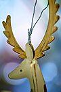 Golden Reindeer by Extraordinary Light