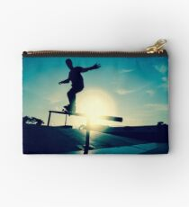 Skateboarder silhouette on a grind Studio Pouch
