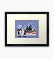 Two Penguins in Snowy Landscape, Whimsical Art Framed Print