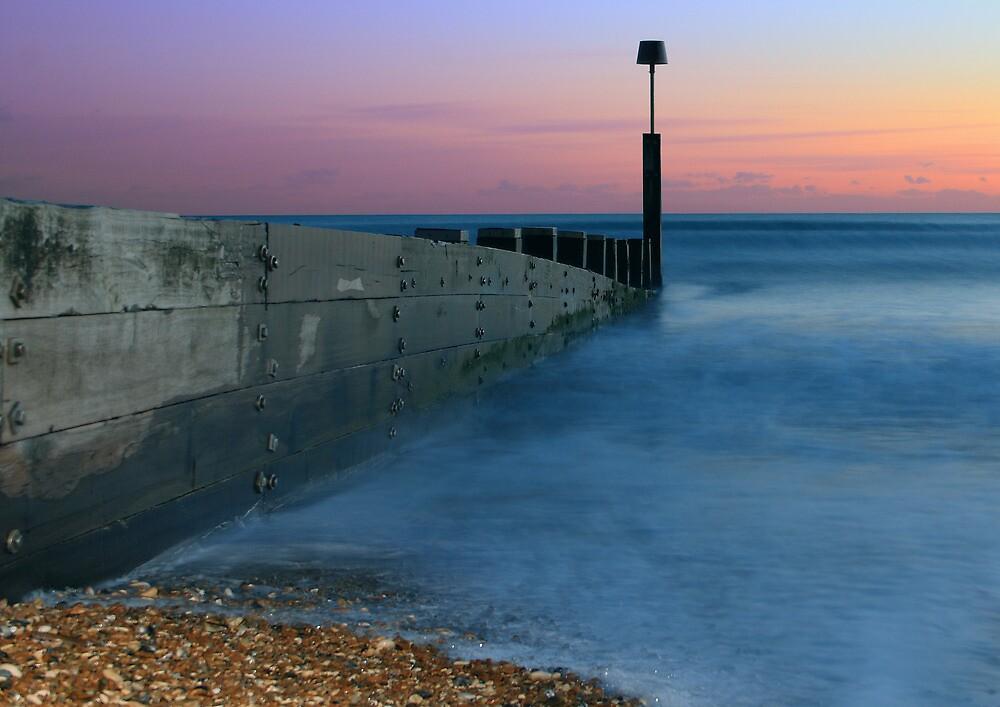Sunset on the beach by Mark Pelleymounter