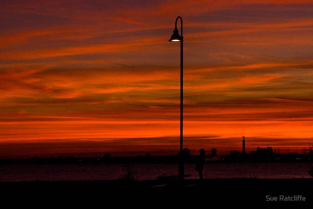 Lamp and Woman in Sunset by Sue Ratcliffe