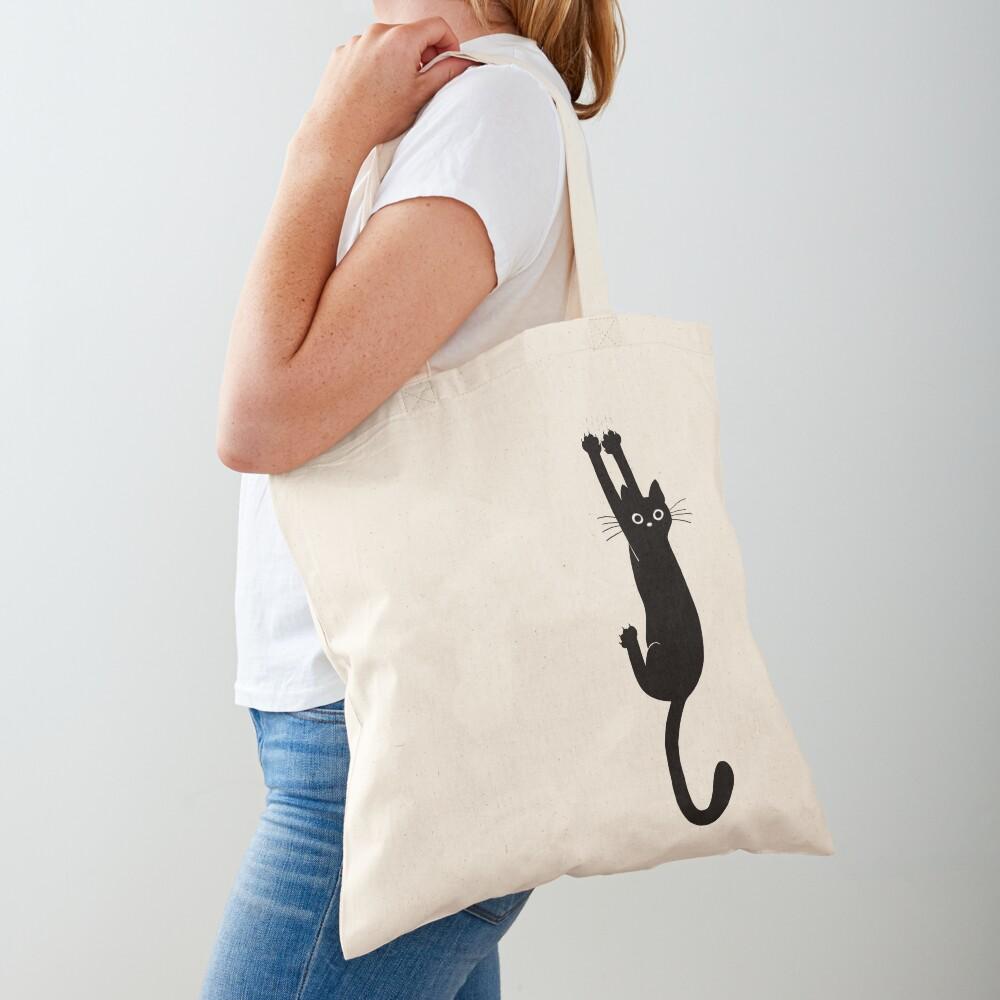 Black Cat Holding On Tote Bag