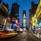 Yellow cab in Times square, New York, USA by Cliff Williams