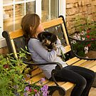 Young Girl & a Puppy Sitting on a Bench by Buckwhite