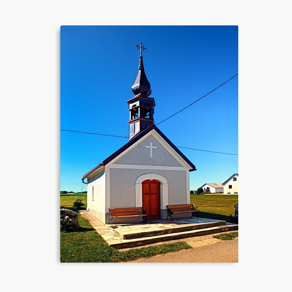 A village chapel with excessive powerlining Canvas Print