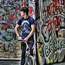 BMX biker waiting to ride by Guy Carpenter