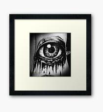 A dead eye Framed Print