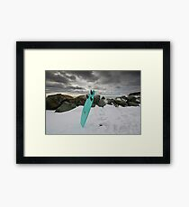 Surfboard in the Snow Framed Print