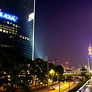 Busy Traffic in Hong Kong - Night View by Richie Wessen