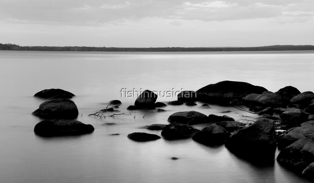 cold lake rocks by fishinmusician