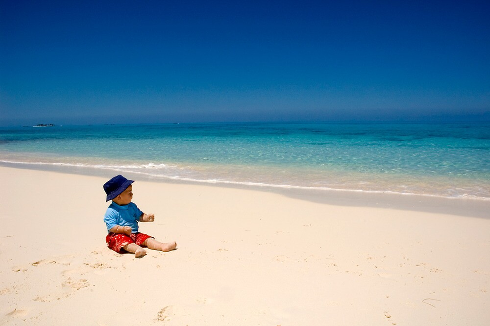 Child playing on Beach, Rose Island, Bahamas by Shane Pinder