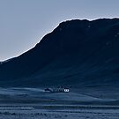 Huts in front of black mountains by DanielAdomian