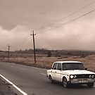 White Lada on a lonely road by DanielAdomian